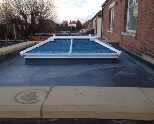 extension with parapet wall and sky lantern